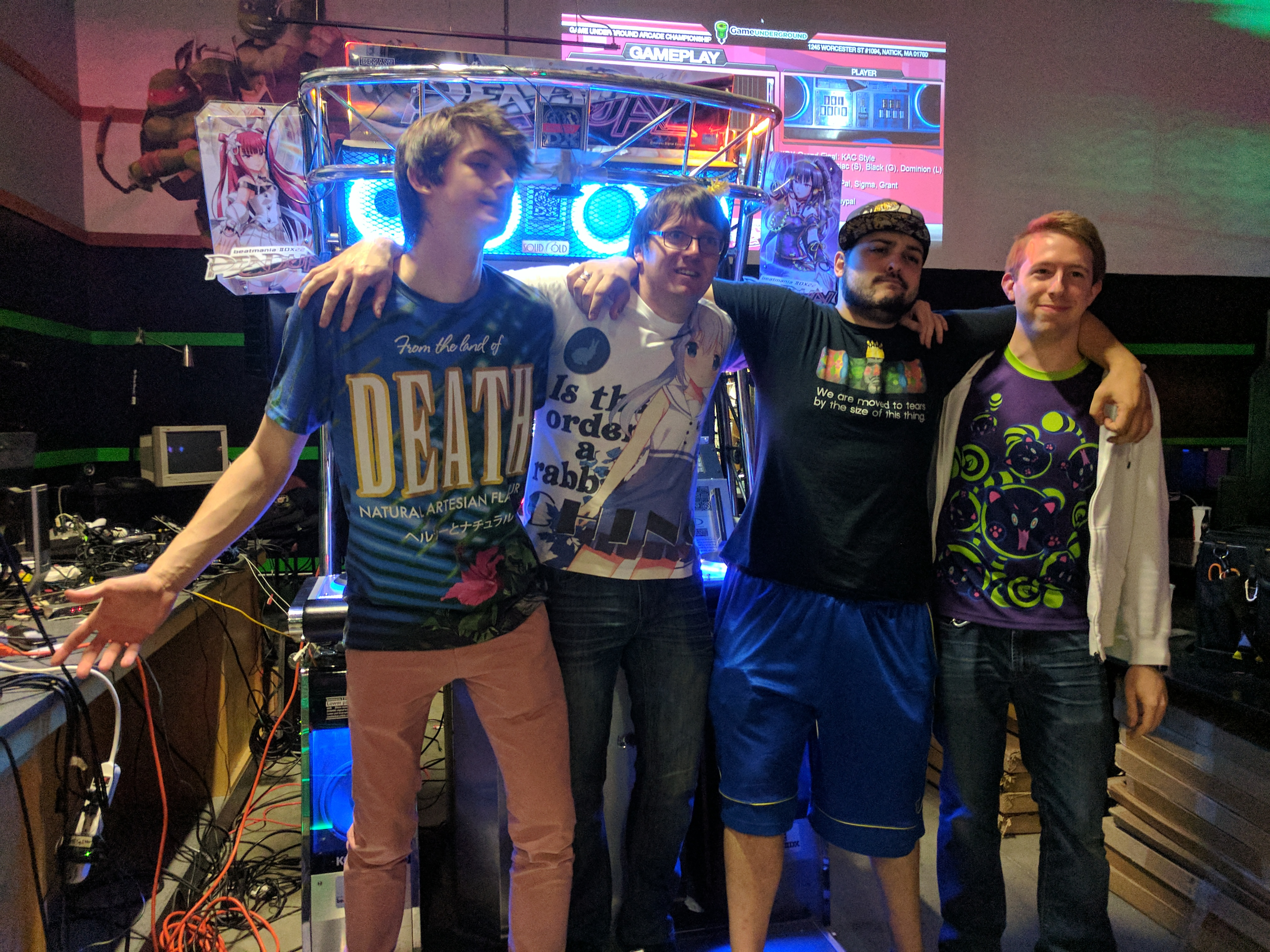 beatmania IIDX Top 4 winners left to right: PayPal (2nd), Grant (1st), Sigma (3rd), Light (4th)